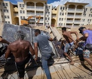RINCON, PUERTO RICO - JUL 24: Grupo de ciudadanos protesta en contra de la construccion de una piscina en el condominio Sol y Playa en la playa Los Almendros.