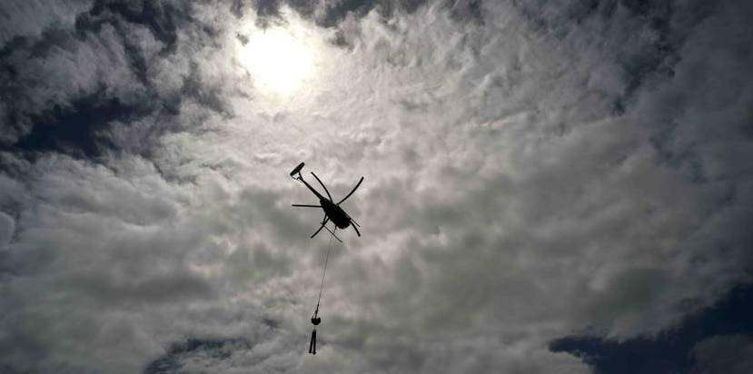 A helicopter of Whitefish Energy Holdings flies to a place where repairs will be made on power lines after Maria. (AP)
