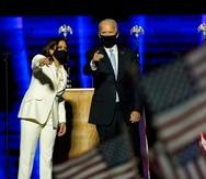 President-elect Joe Biden, right, on stage with Vice President-elect Kamala Harris, left, Saturday, Nov. 7, 2020, in Wilmington, Del. (AP Photo/Andrew Harnik, Pool)