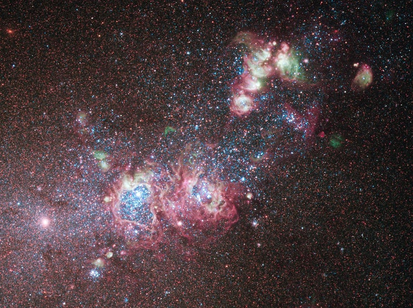 "This NASA image released on May 13, 2011 shows the dwarf galaxy NGC 4214  ablaze with young stars and gas clouds. Located around 10 million light-years away in the constellation of Canes Venatici (The Hunting Dogs), the galaxy's close proximity, combined with the wide variety of evolutionary stages among the stars, make it an ideal laboratory to research the triggers of star formation and evolution. This color image was taken using the Hubble Space Telescope's Wide Field Camera 3 in December 2009. AFP PHOTO/NASA/HANDOUT/RESTRICTED TO EDITORIAL USE - MANDATORY CREDIT "" AFP PHOTO / - NO MARKETING NO ADVERTISING CAMPAIGNS - DISTRIBUTED AS A SERVICE TO CLIENTS"