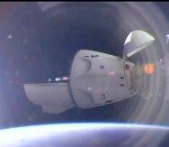 La nave espacial SpaceX Crew Dragon se acopla en la Estación Espacial Internacional, el sábado 24 de abril de 2021.