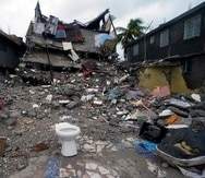 A building lays in ruins three days after a 7.2-magnitude earthquake and the morning after Tropical Storm Grace swept over Les Cayes, Haiti, Tuesday, Aug. 17, 2021. (AP Photo/Fernando Llano)