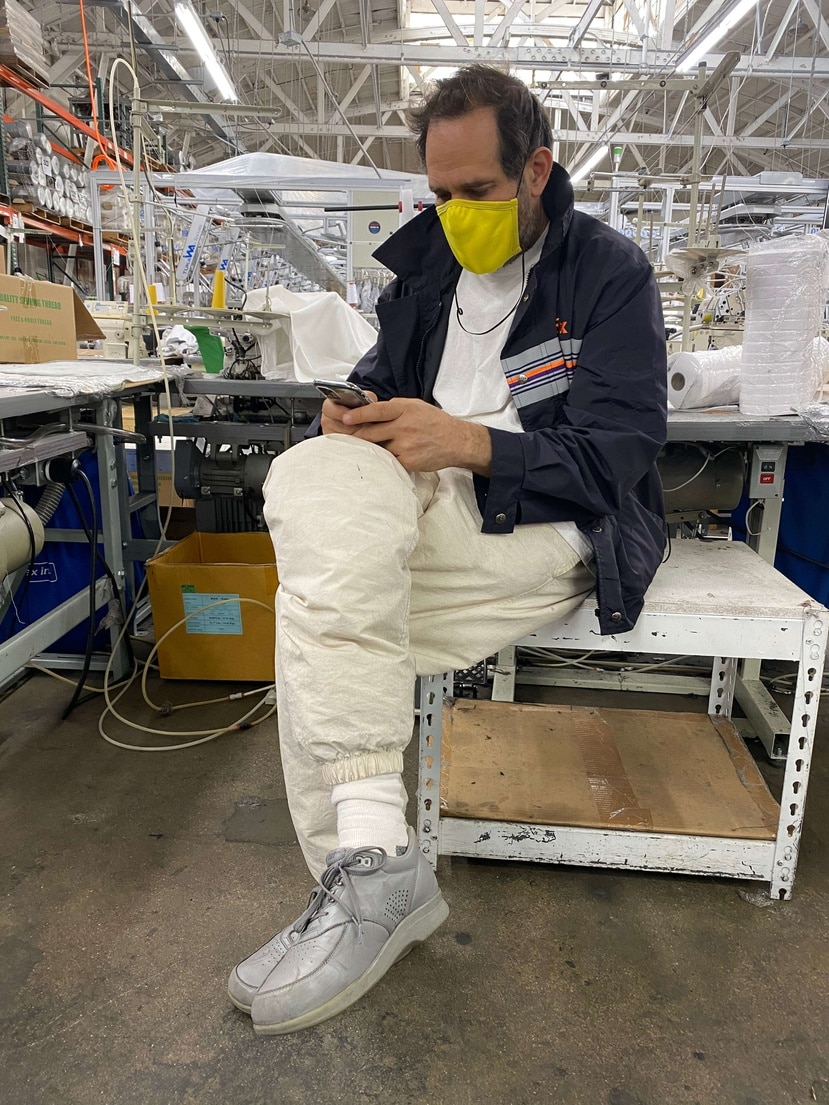 In an undated image provided via Los Angeles Apparel, Dov Charney in his factory in Los Angeles, wearing one of his own masks. But on July 10, 2020, the Los Angeles County Department of Public Health ordered Charney's manufacturing facility to close: An investigation found over 300 confirmed coronavirus infections among the garment workers, and four deaths. (via Los Angeles Apparel via The New York Times) -- NO SALES; FOR EDITORIAL USE ONLY WITH NYT STORY CALIF FACTORY VIRUS BY VANESSA FRIEDMAN FOR JULY 13, 2020. ALL OTHER USE PROHIBITED. --