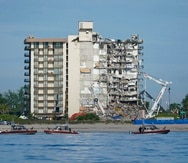 U.S. Coast Guard boats patrol in front of the partially collapsed Champlain Towers South condo building, ahead of a planned visit to the site by President Joe Biden, on Thursday, July 1, 2021, in Surfside, Fla. Rescue efforts at the site of the partially collapsed condominium building were halted Thursday out of concern about the stability of the remaining structure, officials said.