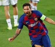 Lionel Messi celebra luego de marcar su segundo gol en el partido.