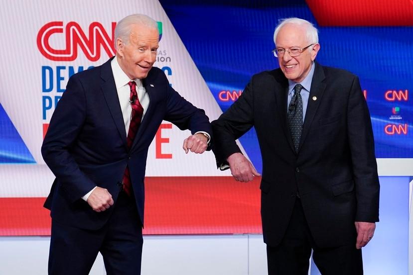 Joe Biden y Bernie Sanders. (AP)