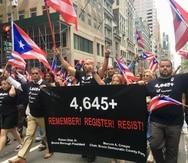 In black and referring to the 4,645 victims of Hurricane María, according to a Harvard University study, Rubén Díaz Jr.,  the Borough President of the Bronx in New York City, Congressman Adriano Espaillat and Assemblyman Marcos A. Crespo carried a banner