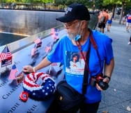 Puerto Rican Robert Mulero pays tribute to his cousin María Isabel Ramírez at the September 11, 2001 memorial in Lower Manhattan.