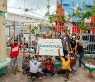 Un grupo de jóvenes y adultos de la comunidad El Gandul participan en el proyecto MIRA EL GANDUL 2020.