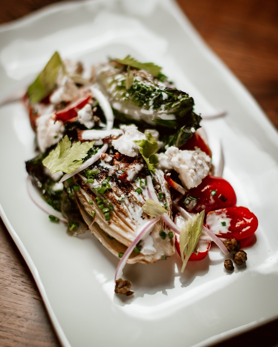 Restaurante La Central: charred Romaine and Tomatoes, Red Onions, Bacon and Capers dressed with Maytag Blue.
