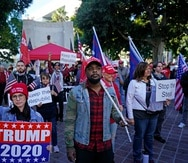 Protesters listen to speakers outside of City Hall Wednesday, Jan. 6, 2021, in Los Angeles. Demonstrators, supporting President Donald Trump, are gathering in various parts of Southern California as Congress debates to affirm President-elect Joe Biden's electoral victory. (AP Photo/Marcio Jose Sanchez)
