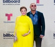 Wisin, right, and Yomaira Ortiz Feliciano arrive at the Billboard Latin Music Awards on Thursday, Sept. 23, 2021, at the Watsco Center in Coral Gables, Fla. (AP Photo/Marta Lavandier)