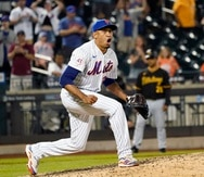 New York Mets relief pitcher Edwin Diaz reacts after striking out Pittsburgh Pirates' Bryan Reynolds during the seventh inning of the second baseball game of a doubleheader, Saturday, July 10, 2021, in New York. (AP Photo/Mary Altaffer)