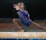 Simone Biles, of the United States, performs on the balance beam during the women's artistic gymnastic qualifications at the 2020 Summer Olympics, Sunday, July 25, 2021, in Tokyo. (AP Photo/Natacha Pisarenko)