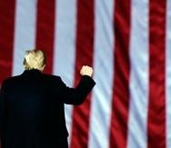 President Donald Trump gestures at a campaign rally in support of Senate candidates Sen. Kelly Loeffler, R-Ga., and David Perdue in Dalton, Ga., Monday, Jan. 4, 2021. (AP Photo/Brynn Anderson)