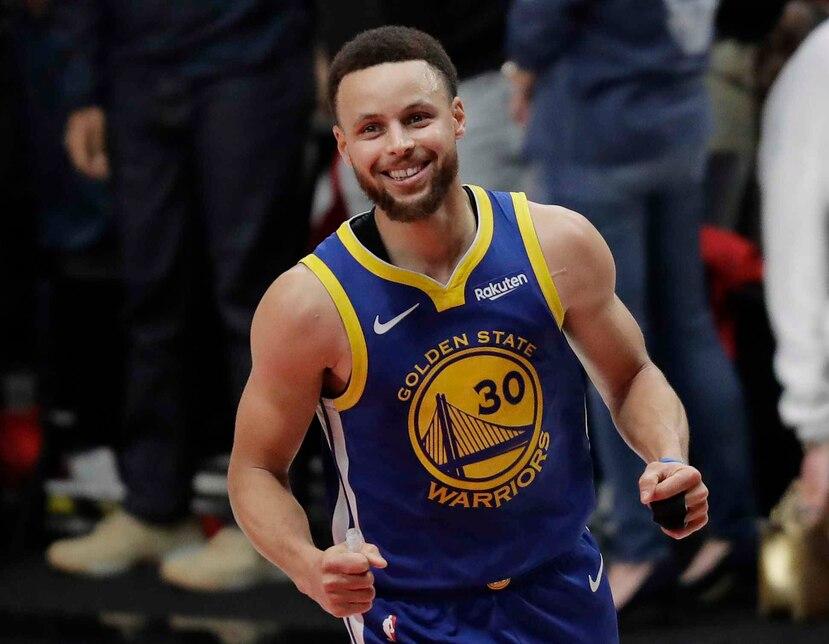 Curry anotó 37 puntos. (AP)