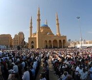 Lebanese people perform Friday first prayer in front of the Mohammed al-Amin Mosque in downtown Beirut, Lebanon, Friday, Oct. 17, 2008. The Mosque was built by slain Prime Minister Rafik Hariri and after was buried in a grave site adjacent to the Mosque. (AP Photo/Mahmoud Tawil)