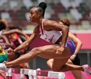 Jasmine Camacho-Quinn, of Puerto Rico, runs in her heat of the women's 100-meter hurdles at the 2020 Summer Olympics, Saturday, July 31, 2021, in Tokyo. (AP Photo/David J. Phillip)