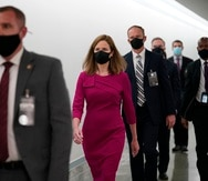 Supreme Court nominee Amy Coney Barrett walks back after a break on Capitol Hill to continue her confirmation hearing before the Senate Judiciary Committee, Monday, Oct. 12, 2020 on Capitol Hill in Washington. (AP Photo/J. Scott Applewhite)