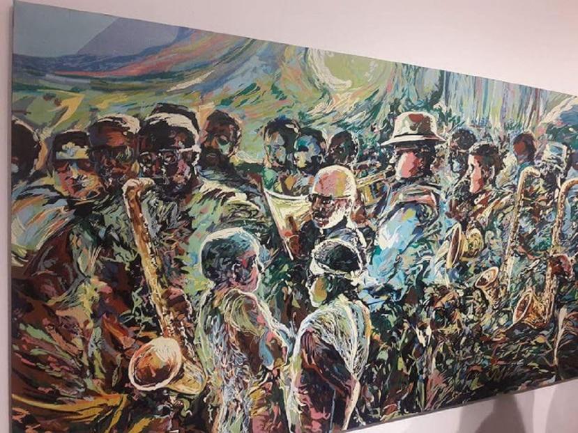 """""""Comparsa caribeña"""", óleo sobre lienzo, 96""""x48"""", de Wichie Torres que se exhibe en la galería universitaria. (Suministrada)"""