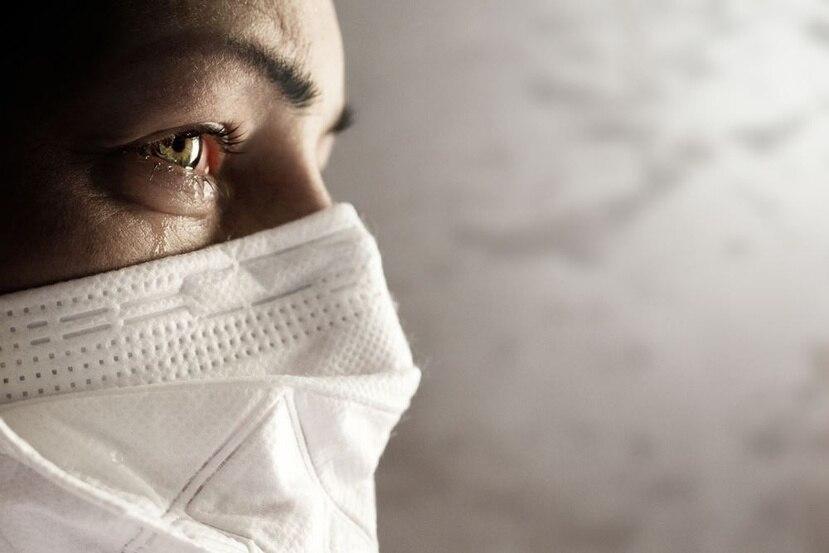 Mujer con mascarilla. (Shutterstock)