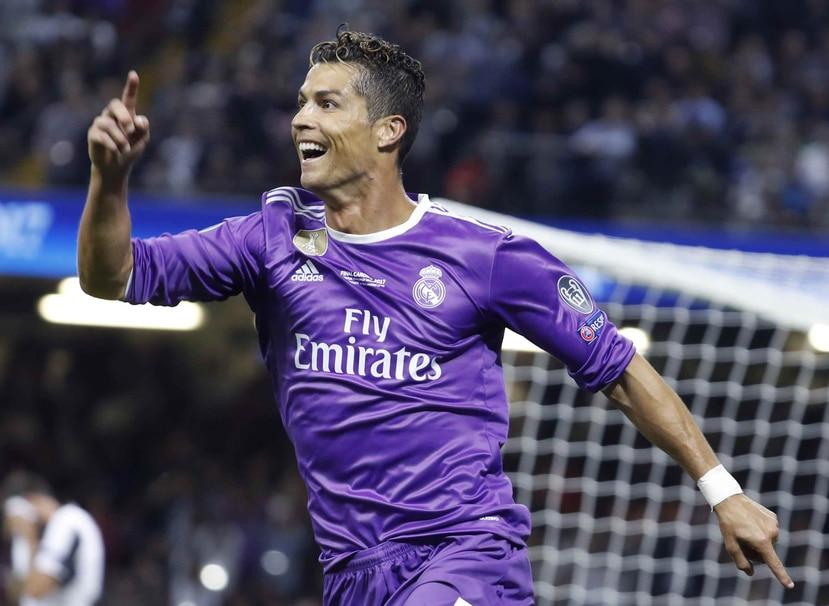 Cristiano Ronaldo es el tercer jugador del Real Madrid en salir en la portada mundial del FIFA. (EFE)