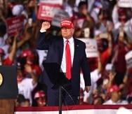 President Donald Trump leaves his campaign rally at Opa-Locka Executive Airport, early Monday, Nov. 2, 2020, in Opa-Locka, Fla. (AP Photo/Jim Rassol)