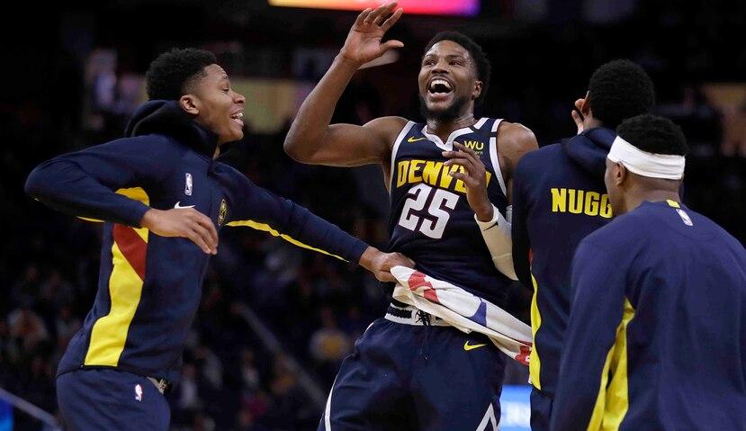 El jugador de los Nuggets de Denver Malik Beasley celebra una canasta en la segunda mitad del juego de la NBA que enfrentó a su equipo con los Warriors de Golden State, el 16 de enero de 2020, en San Francisco. (AP Foto/Ben Margot)