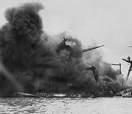 This US Navy file iamge shows The USS Arizona afire and sinking after the Japanese attack on Pearl Harbor on December 7, 1941. December 7, 2008 marks the 67th anniversary of the attack which drew the US into WWII. AFP PHOTO/HO/US Navy