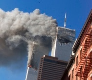 FILE - Smoke rises from the burning twin towers of the World Trade Center after hijacked planes crashed into the towers on September 11, 2001 in New York City.  Associated Press photographer Richard Drew talks about AP's coverage of 9/11 and the events that followed. (AP Photo/Richard Drew)