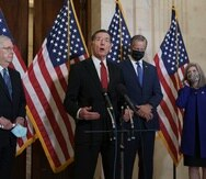"""John Barrasso, center, has said that the Democratic Party """"has moved far left"""" with proposals such as making Puerto Rico and Washington D.C. states, while Senate Majority Leader, Republican Mitch McConnell (left), said that both proposals are part of the Democrats' """"socialist agenda""""."""