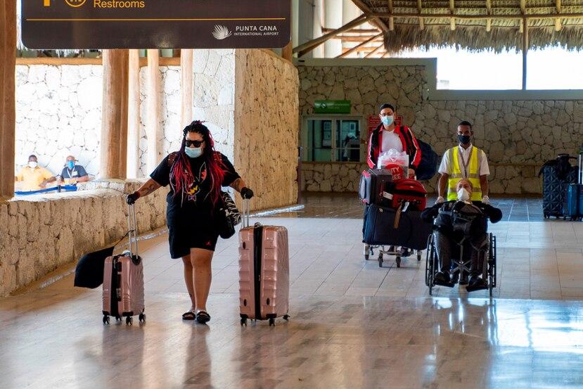 Pasajeros que llegan a Punta Cana, en un vuelto que aterriza en el Aeropuerto Internacional de Punta Cana, en República Dominicana.