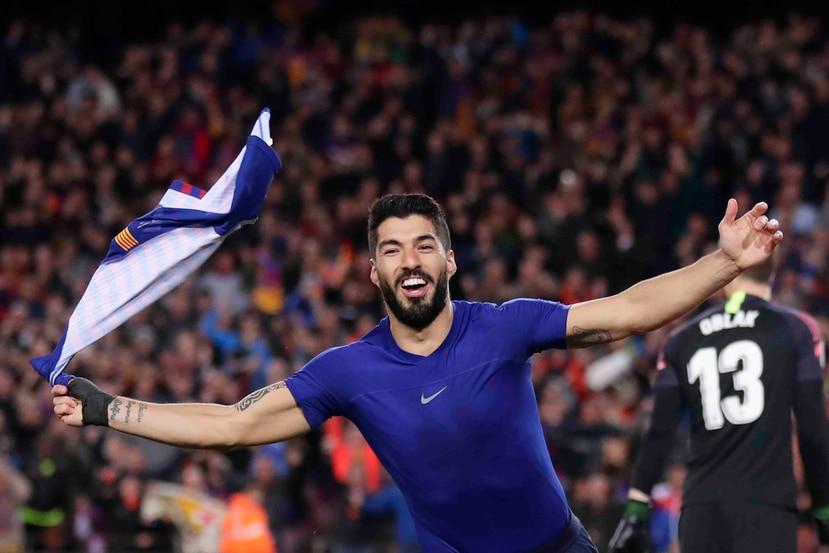 Luis Súarez celebra su gol en el partido. (AP)
