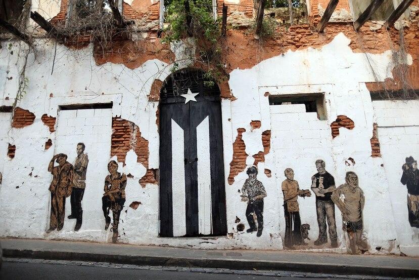 """La acción de pintar de blanco y negro la enseña nacional pretende ser un acto de """"resistencia""""."""