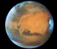 Los polos y nubes de Marte en una imagen tomada por el Hubble. (NASA / Telescopio espacial Hubble)