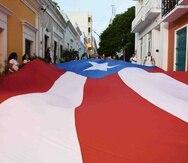 Bandera de Puerto Rico desplegada en el Viejo San Juan como parte de las protestas en reclamo de la renuncia de Ricardo Rosselló.