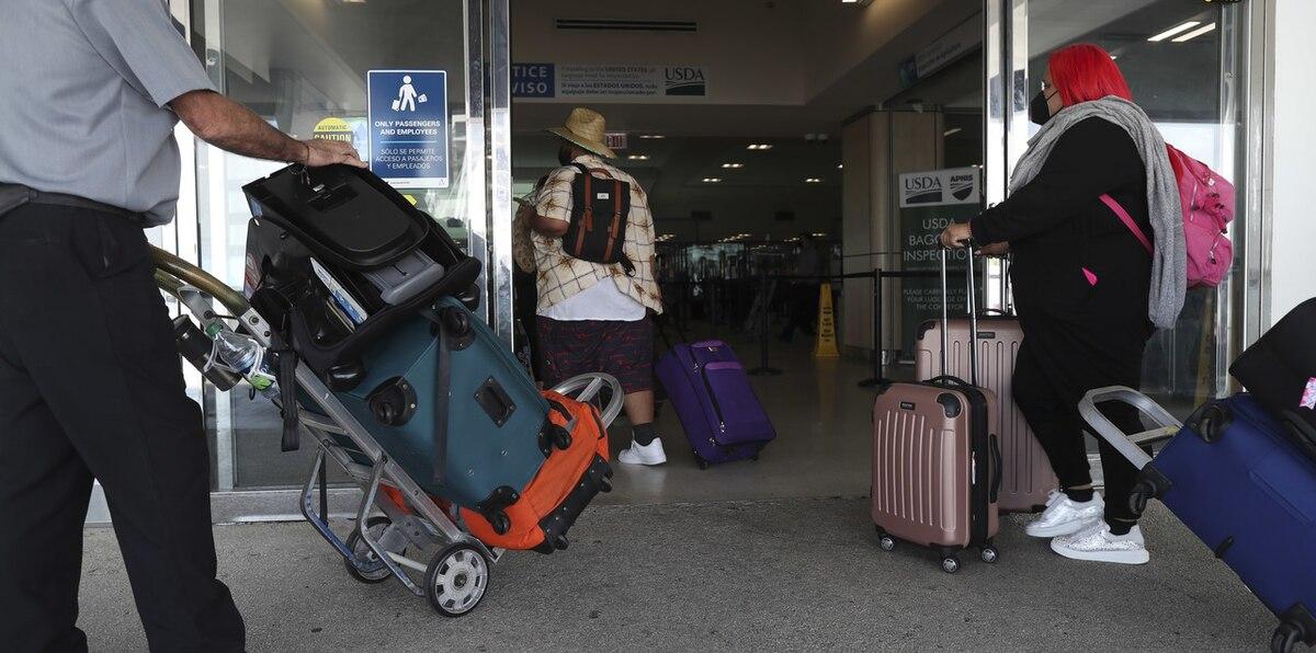 En el aeropuerto: ¿por qué viajas a Puerto Rico?