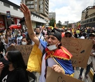 Protesters march during an anti-government demonstration in Bogota, Colombia, Wednesday, May 5, 2021. Protests that began last week over a tax reform proposal continue despite President Ivan Duque's withdrawal of the tax plan on Sunday, May 2. (AP Photo/Fernando Vergara)