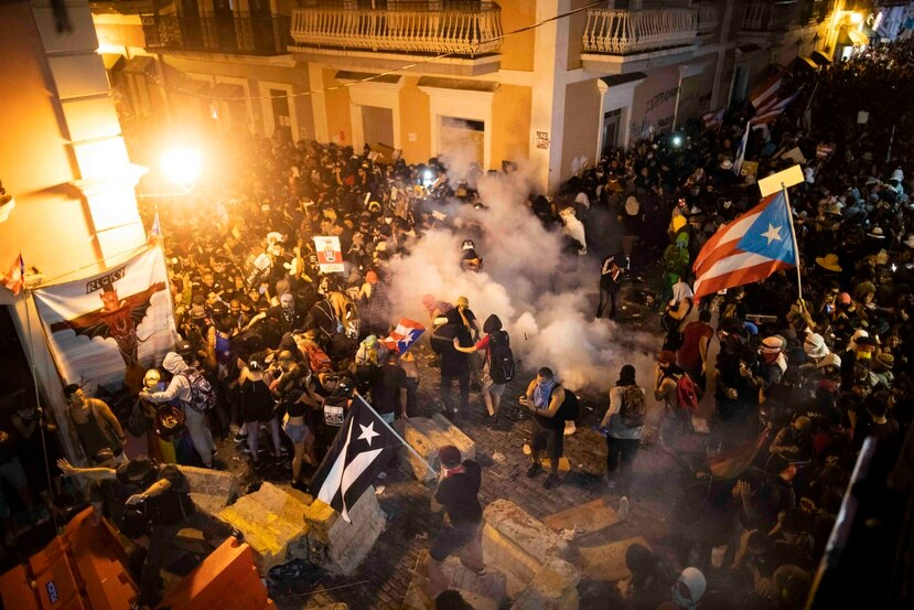 After a box of pyrotechnics exploded, police began to fire tear gas canisters into the crowd and cleared out the surrounding streets.