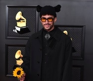 Bad Bunny arrives at the 63rd annual Grammy Awards at the Los Angeles Convention Center on Sunday, March 14, 2021. (Photo by Jordan Strauss/Invision/AP)