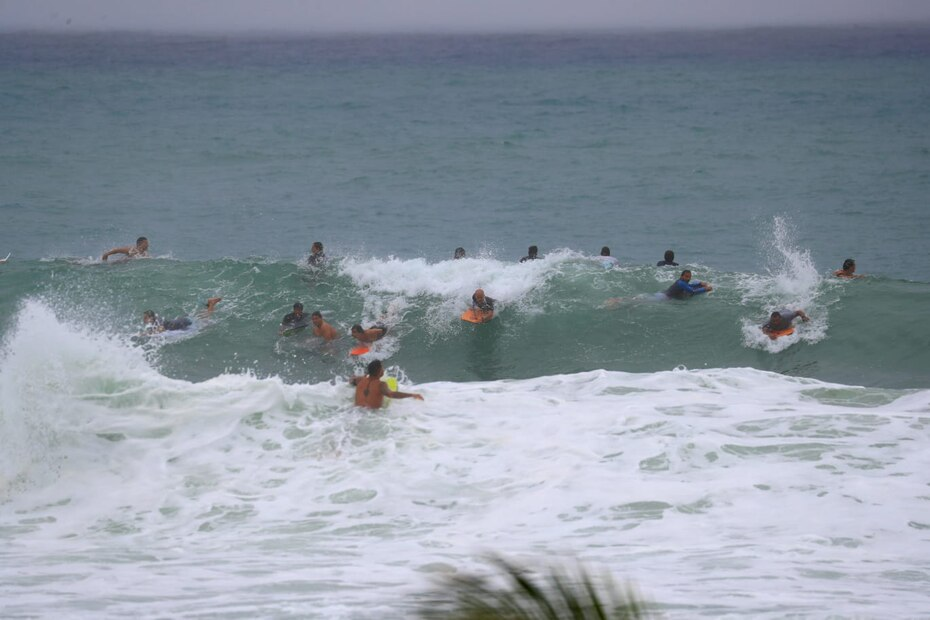 More than 20 surfers jumped into the sea looking for the waves generated by storm Laura in Puerto Rico.