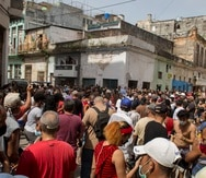 A anti-government protesters march in Havana, Cuba, Sunday, July 11, 2021. Hundreds of demonstrators went out to the streets in several cities in Cuba to protest against ongoing food shortages and high prices of foodstuffs. (AP Photo/Ismael Francisco)