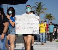 Estudiantes de la UPR participaron ayer de la manifestación convocada frente al Capitolio para rechazar el proyecto de la Cámara 1003, que fue aprobado en horas de la noche por la Legislatura y firmada por el gobernador Pedro Pierluisi.