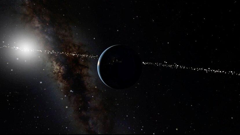 Esta ilustración provista por el Museo de Historia Natural en Nueva York muestra el planeta Tierra, al centro, con el sol al trasfondo. La línea de puntos que atraviesa la imagen indica sistemas de estrellas desde donde se puede ver la Tierra cuando pasa frente al sol.